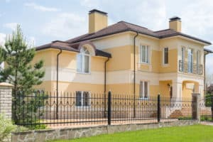 Modern two storey cottage with a wrought fence